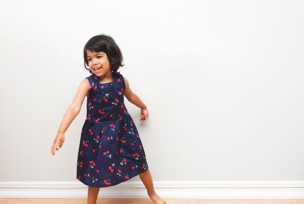 Toddler in a cherry Dress